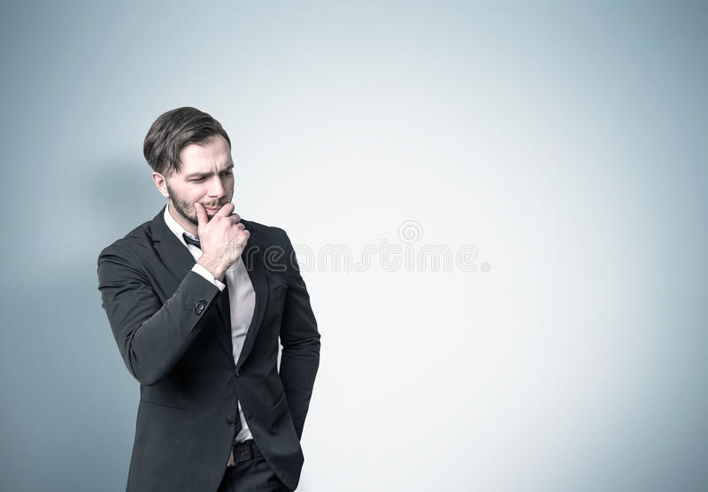 Download Pensive Businessman Near A Blue Wall Stock Photo - Image of choice, background: 83722348