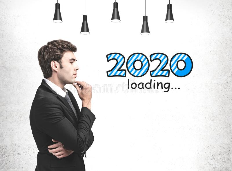 Pensive businessman, year 2020 loading royalty free stock photo