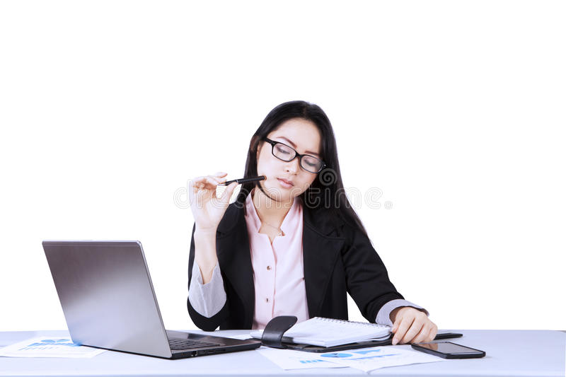 Pensive businesswoman with paperwork on studio royalty free stock photo