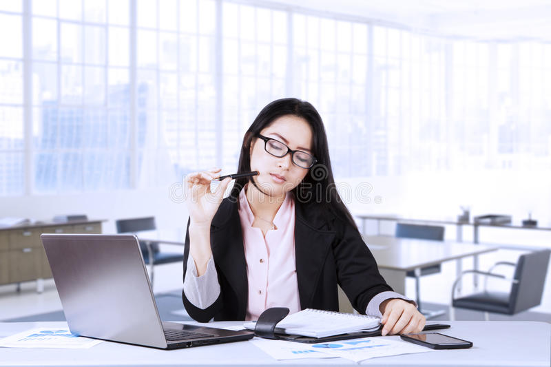 Pensive businesswoman reading a document stock photo