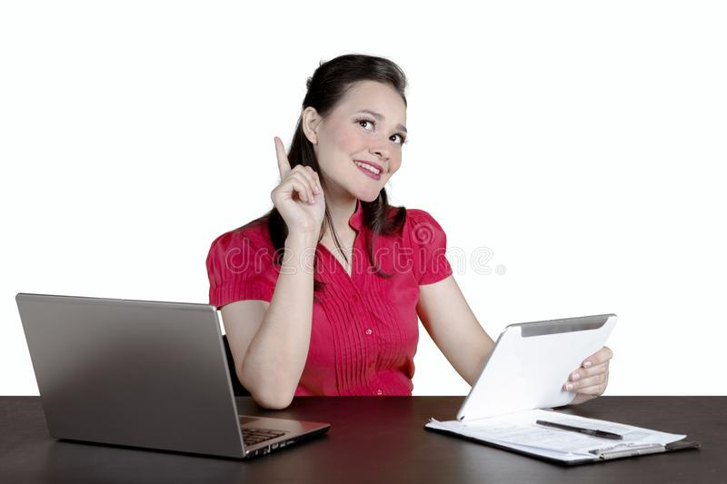 Pensive businesswoman using a tablet on studio stock photography