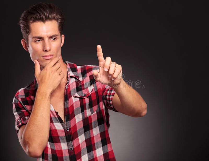 Download Pensive Casual Man Pressing On Blank Screen Stock Photo - Image: 27695070