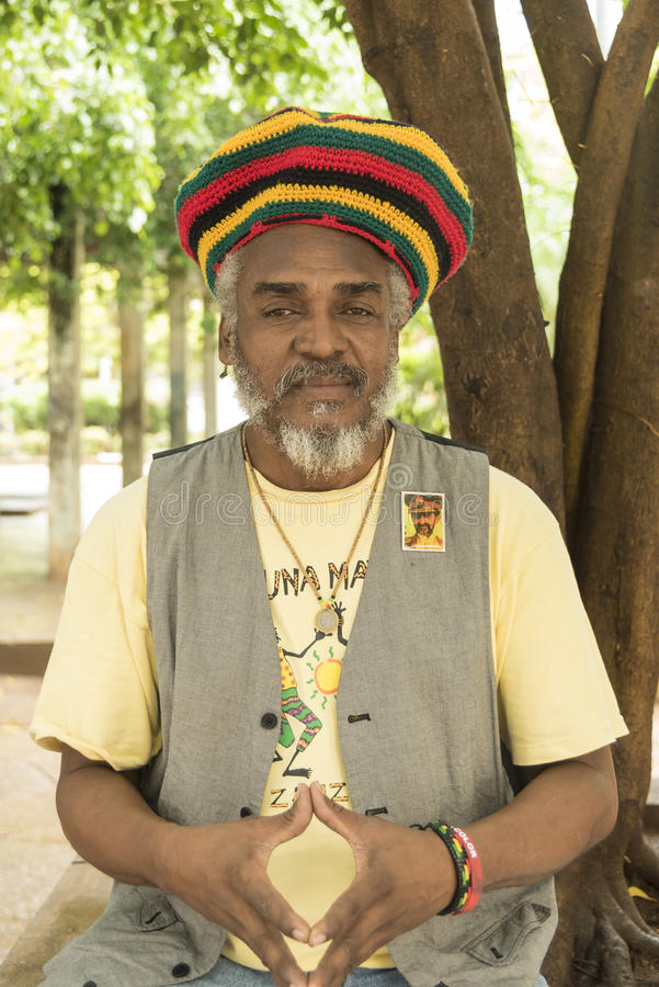 Pensive cuban man with rastafari cap royalty free stock photo