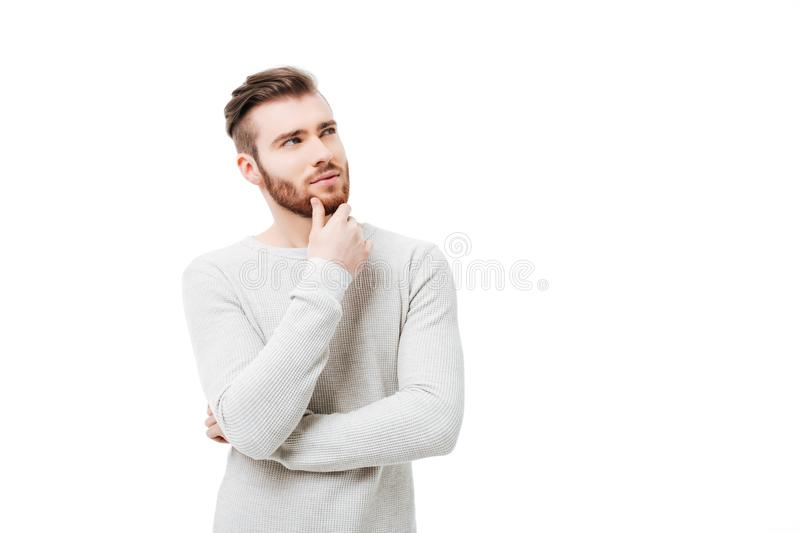 Pensive curious man looking up in thinking pose trying to make choice or desicion isolated stock photo
