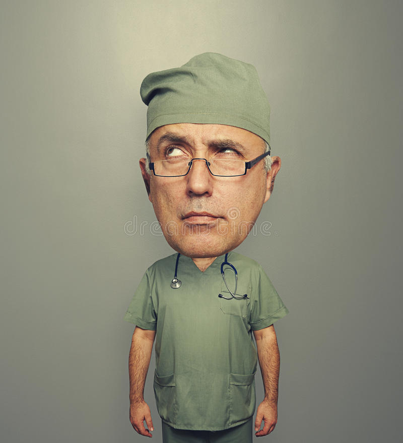 Download Pensive Doctor With Bighead Stock Image - Image: 35124211