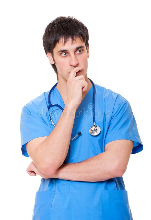 Pensive doctor in blue uniform stock photography