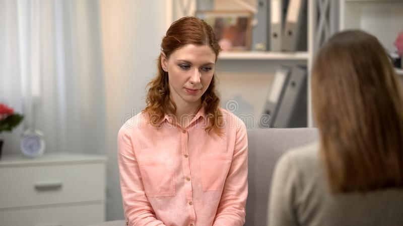 Pensive female feeling guilty, psychological counseling session, mental health royalty free stock photos