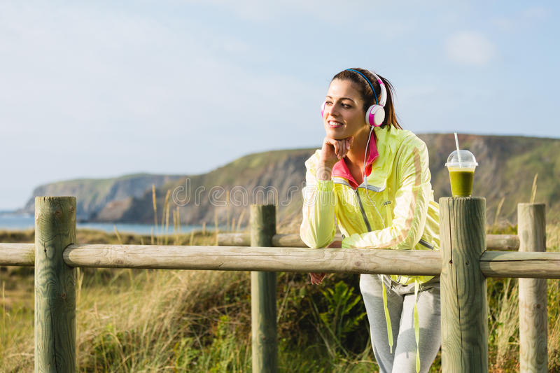 Pensive fitness woman relaxing after workout stock photography