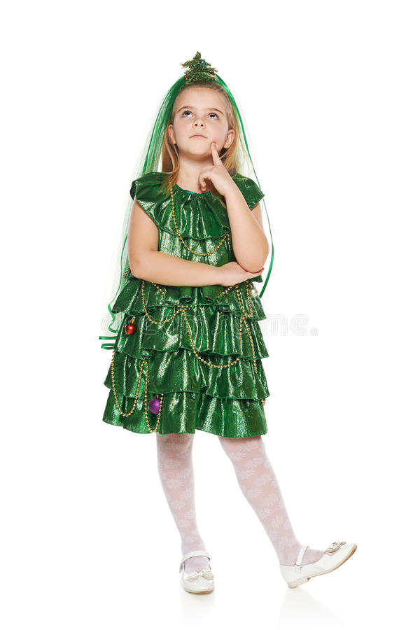 Pensive Girl in Christmas tree costume royalty free stock photography