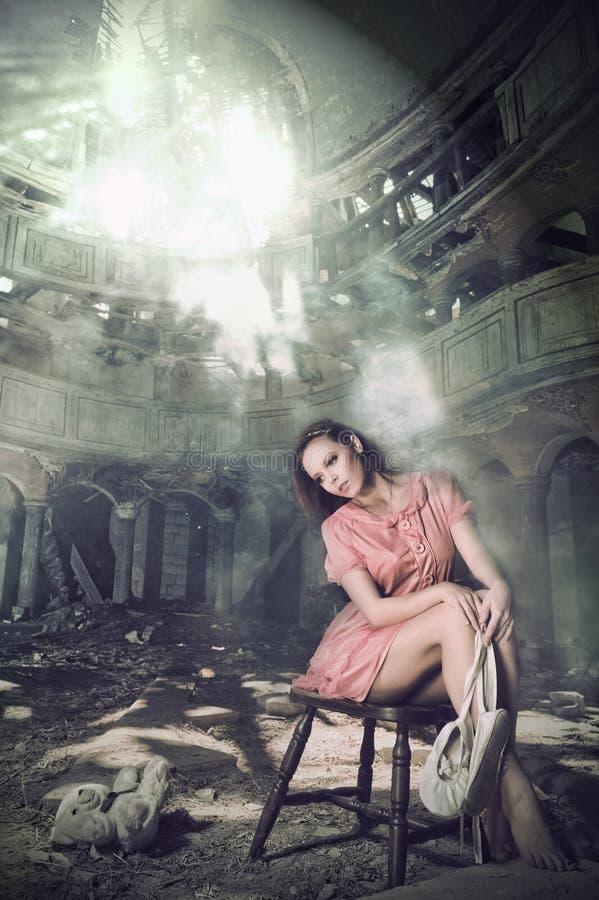Pensive girl dreams of ballet in theatre