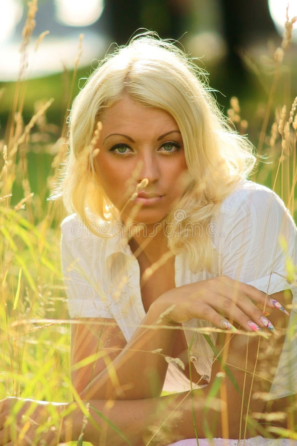 Download Pensive girl in grass stock photo. Image of model, freedom - 15722478