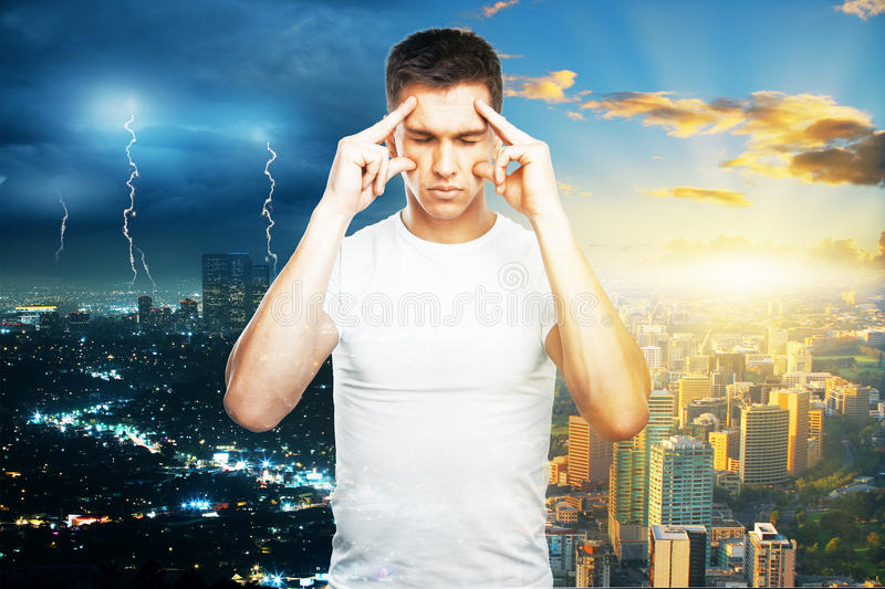 Pensive guy on city background royalty free stock images