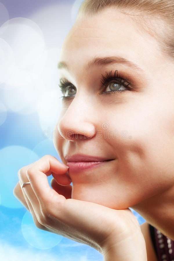Pensive happy beautiful young woman. Bright portrait of pensive happy beautiful young woman royalty free stock images