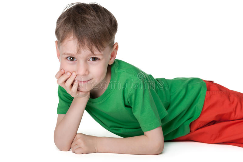 Pensive little boy rests royalty free stock photography