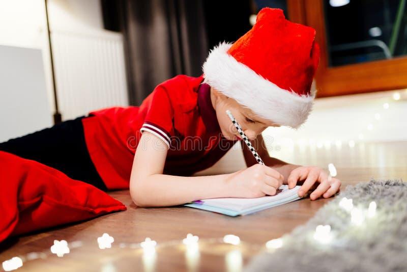 Pensive little boy writing a letter to santa claus stock photo download pensive little boy writing a letter to santa claus stock photo image of december spiritdancerdesigns Gallery