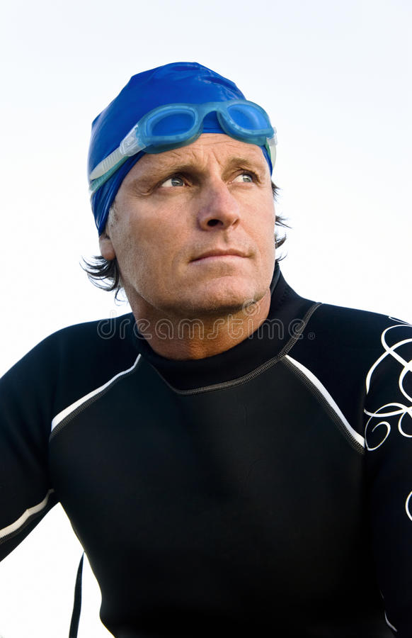 Pensive looking triathlete. stock photos