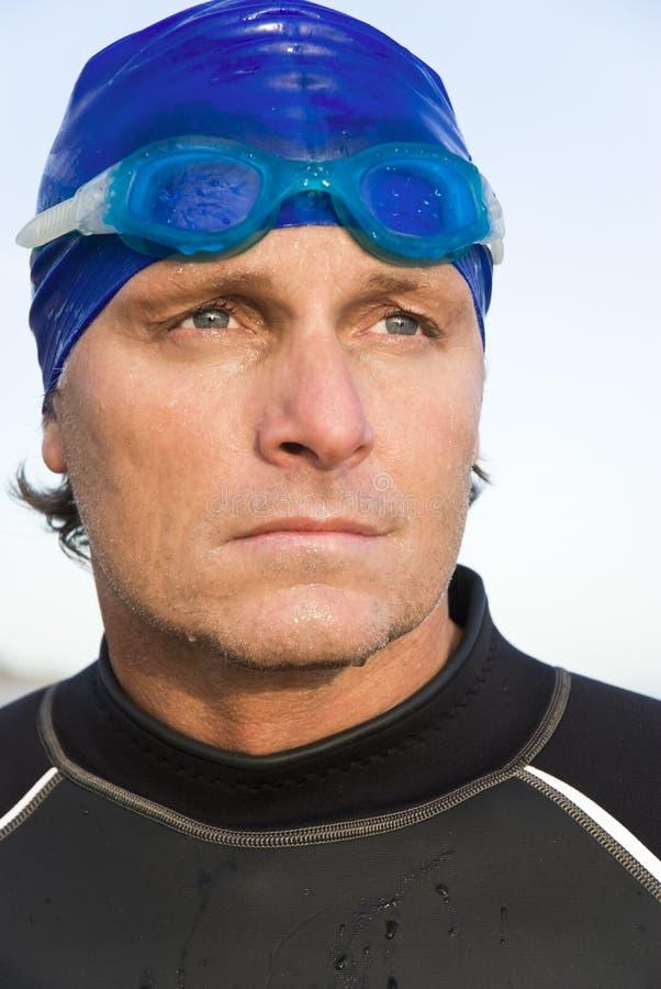 Pensive looking triathlete royalty free stock image