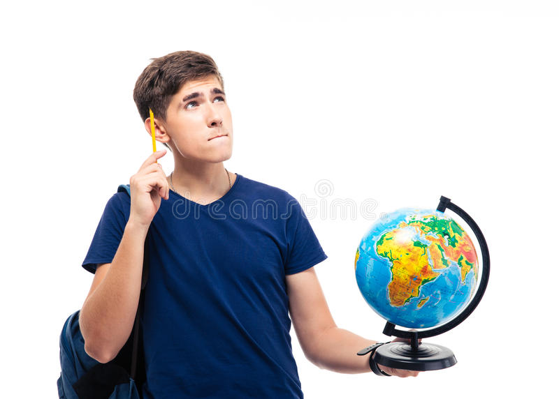 Pensive male student holding globe. Isolated on a white background. Looking up royalty free stock image