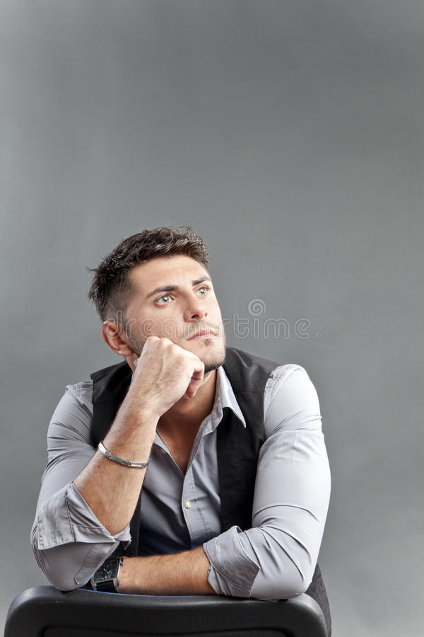 Pensive man. Pensive young man in stress, looking over his shoulder stock photography