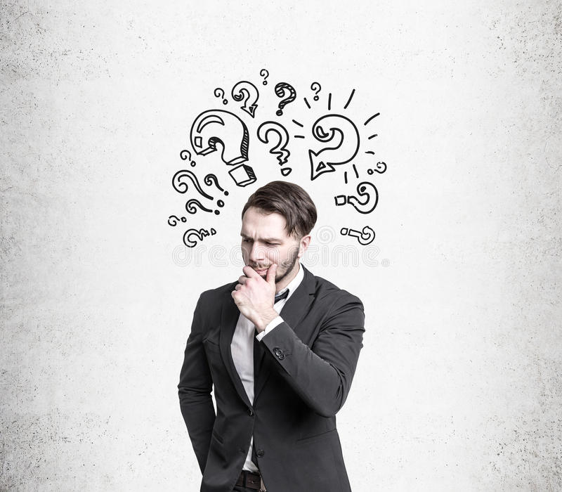 Download Pensive Man Near Question Marks Stock Photo - Image: 83722321