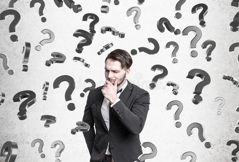 Download Pensive Man, Question Marks Falling Stock Photo - Image: 83722808
