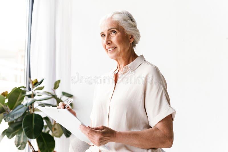 Pensive mature business woman stock photos