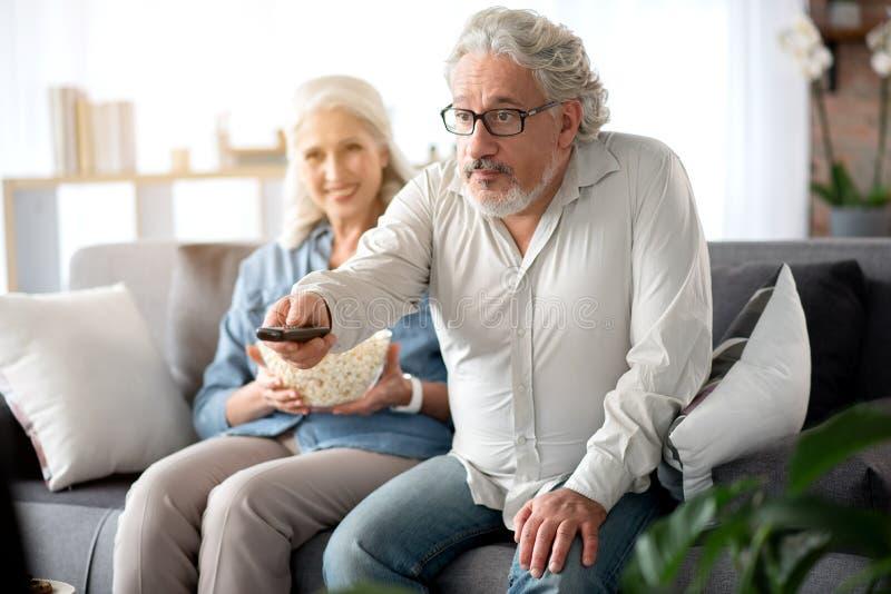 Happy Senior Couple With Remote Stock Photo Image Of