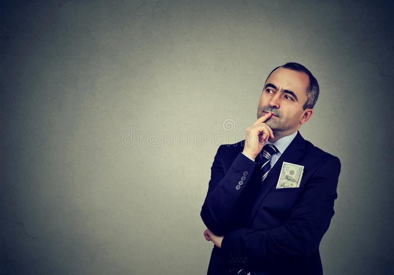 Pensive middle-aged businessman looking away stock photo