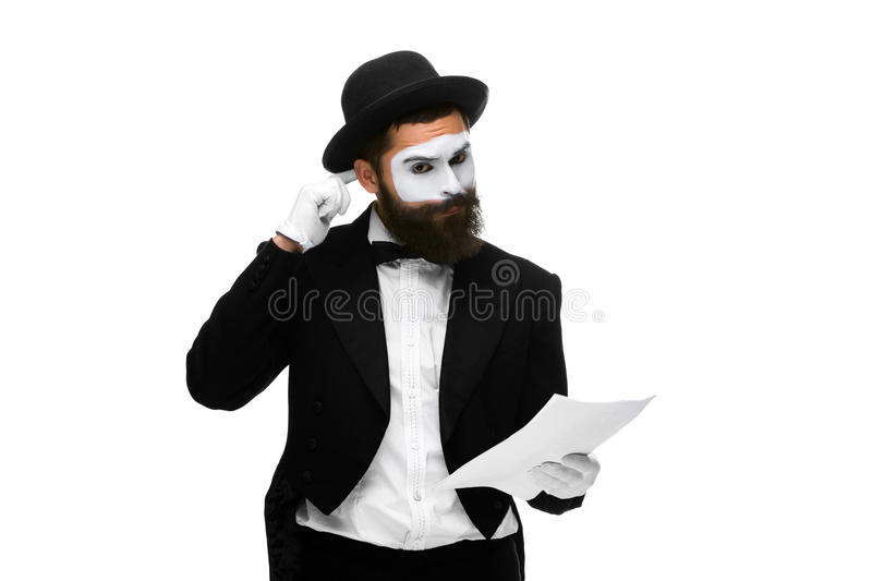 Pensive mime as a businessman reading the list of royalty free stock images
