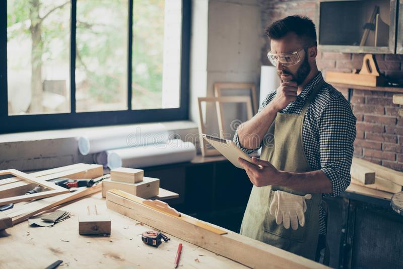 Pensive minded concentrated confident handsome bearded wearing c royalty free stock photo