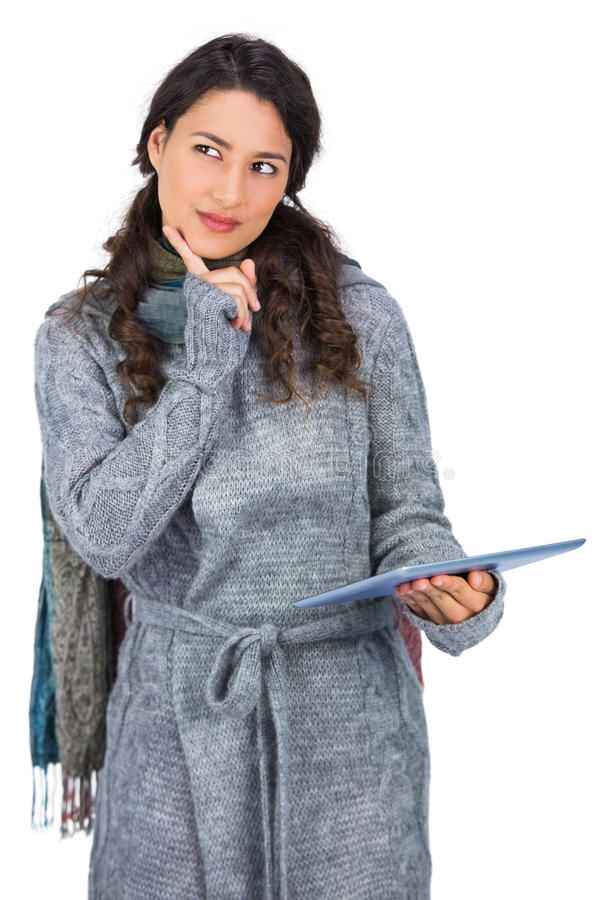Download Pensive Model Wearing Winter Clothes Holding Her Tablet Stock Image - Image: 33107839