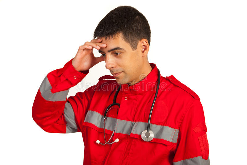 Pensive paramedic man. Holding hand to head isolated on white background stock photo