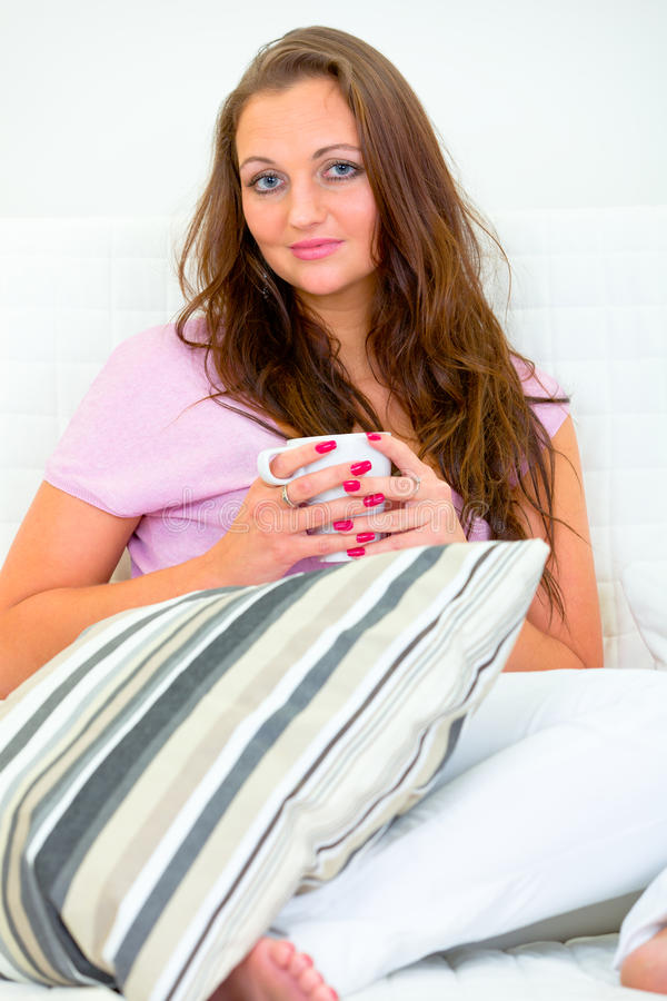 Download Pensive Pretty Woman With Cup Of Coffee On Sofa Stock Image - Image: 18964951