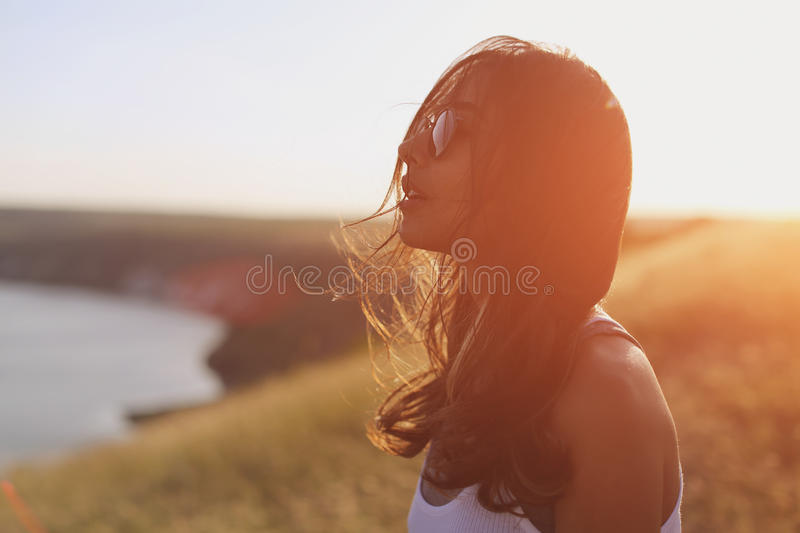 Pensive relaxed girl thinking and looking forward stock photo