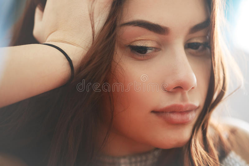 Pensive sad and thoughtful young woman royalty free stock photography