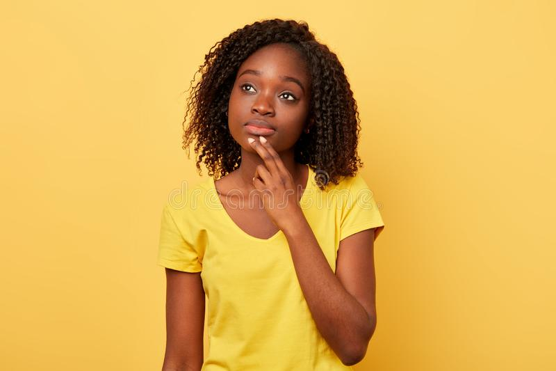 Pensive serious young woman thinking about problem, confused emotion royalty free stock photo