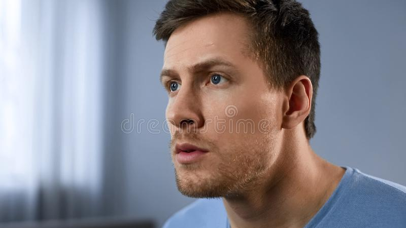 Pensive sight of adult male, face expressing hope, anticipation, new idea. Stock photo stock image
