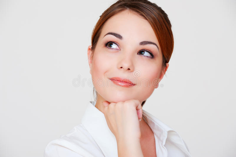 Download Pensive Smiley Woman Looking Up Stock Photo - Image of friendly, pretty: 15946546