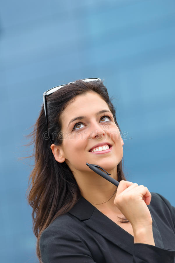 Pensive successful businesswoman royalty free stock images