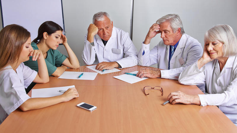 Pensive team of doctors stock images