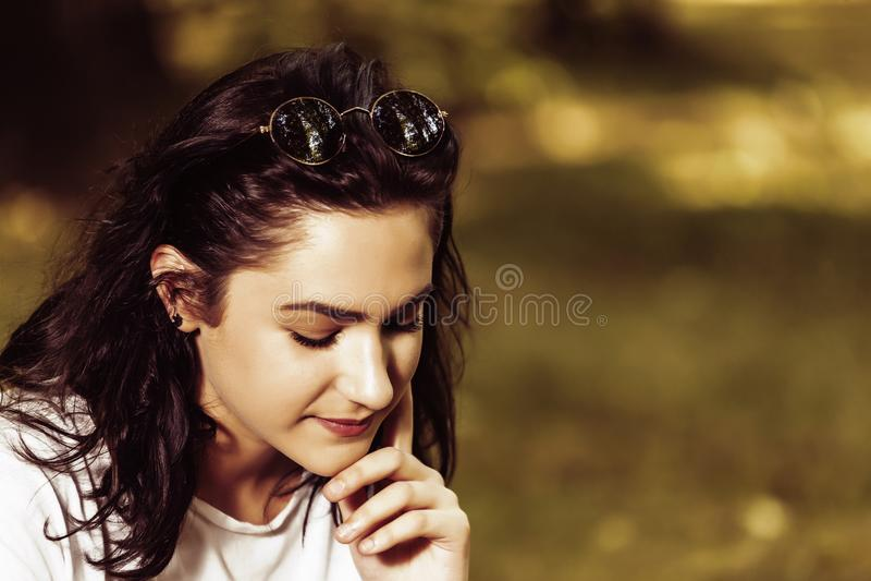 Pensive teenage girl outdoors stock photography