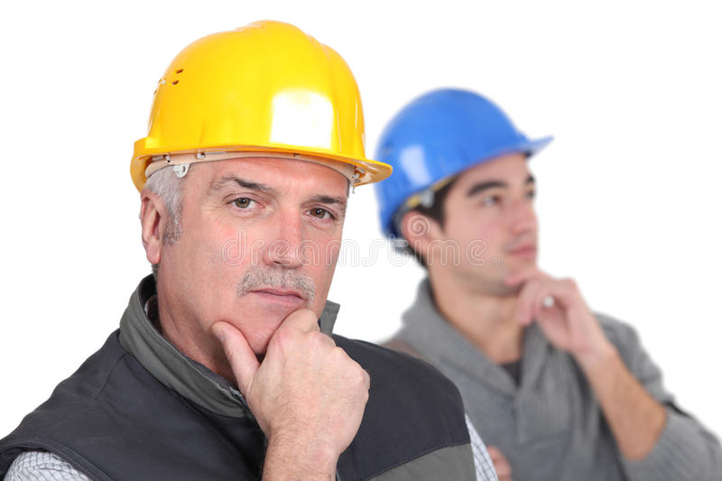 Pensive tradesmen. In problem solving mode royalty free stock photo
