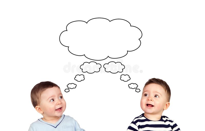 Pensive two twins children looking up stock image