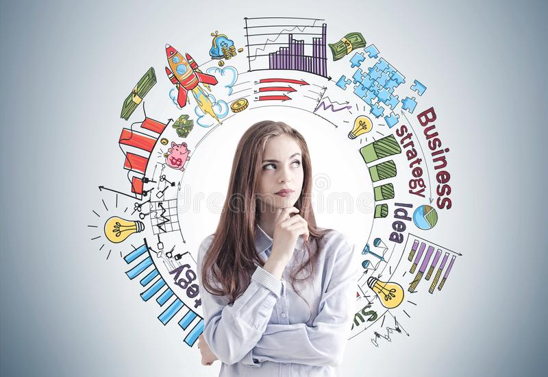 Pensive woman in blue, business plan stock images
