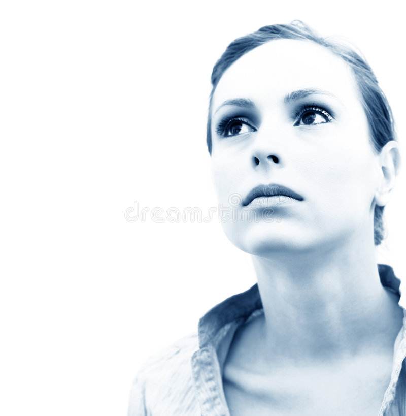 Pensive Woman Blue Tint. Portrait of a pensive young woman on isolated white background. Blue tint added stock image
