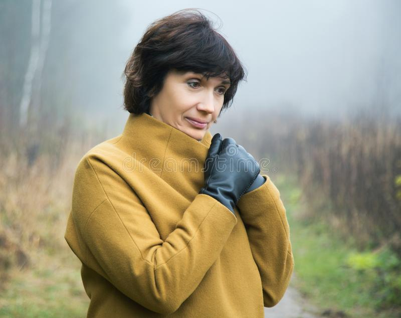 Pensive woman close up on a foggy autumn. Day royalty free stock photo