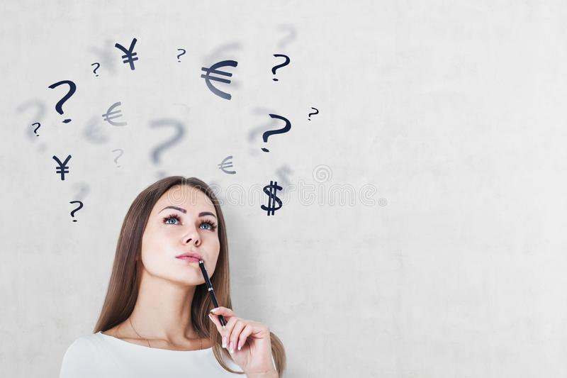 Pensive woman and currency signs stock photos