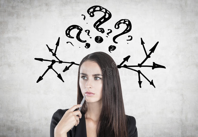 Pensive woman with a pen, questions and arrows stock photos