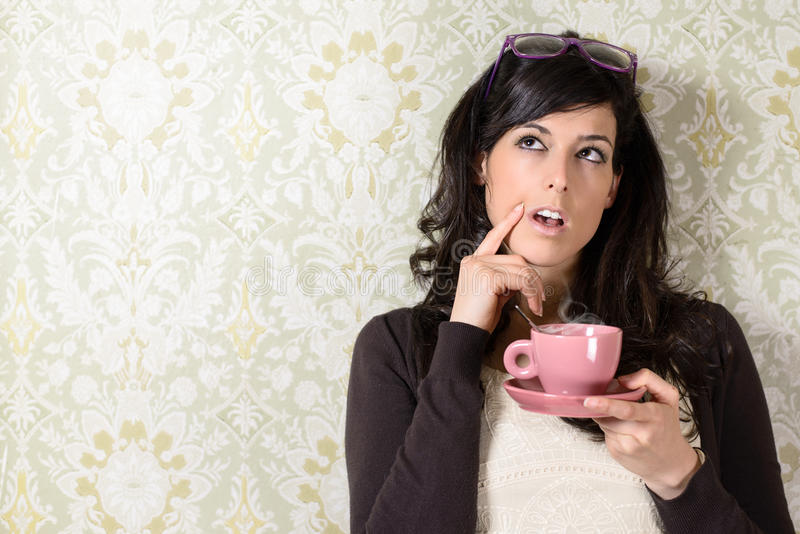 Pensive woman having idea stock photography