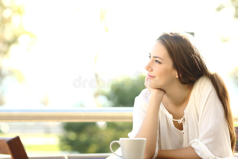 Pensive woman thinking and looking at side royalty free stock image